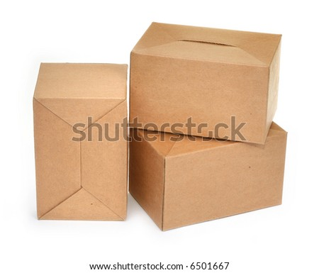 close-up of three cardboard boxes againt white background, minimal natural shadow in front
