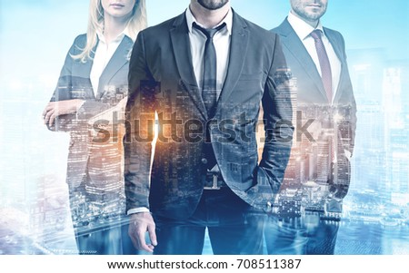 Close up of three members of a business team wearing suits and standing against a city view. Toned image double exposure