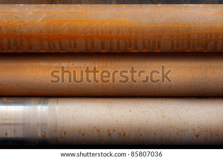 Close up of three rusty steel pipes