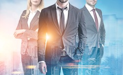Close up of three unrecognizable business people standing together against a blue city panorama. Toned image double exposure
