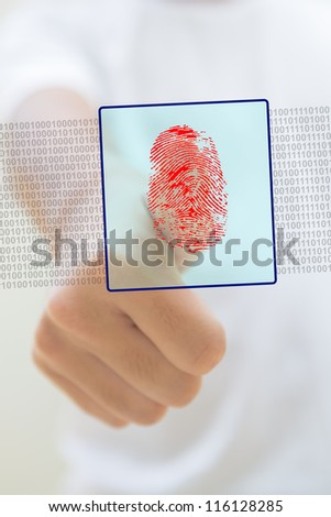 Close-up of thumb with a red fingerprint, security concept