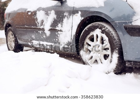 Close up of tire at snow. Winter. Shallow depth of field. #358623830