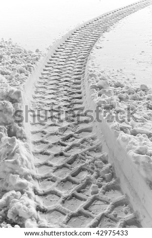 Close up of tire track in untouched snow