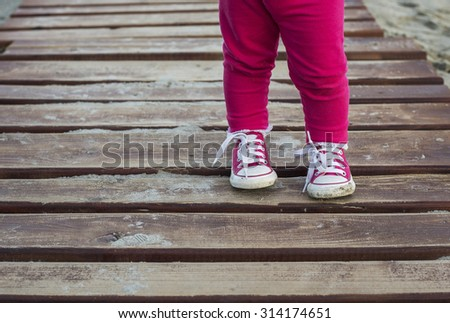 Close up of toddler making his first steps