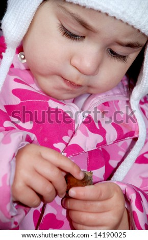 close up of toddler playing with a leaf
