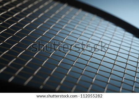 Close-up of top of tennis racket