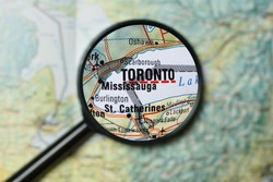Close up of Toronto under a magnifying glass on a map