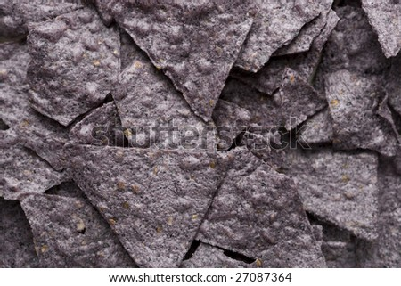 Close up of tortilla chips made from blue corn.