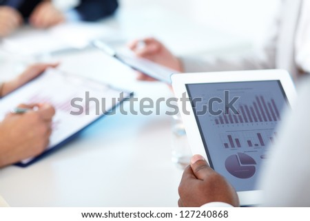 Close-up of touchpad in businessman hands