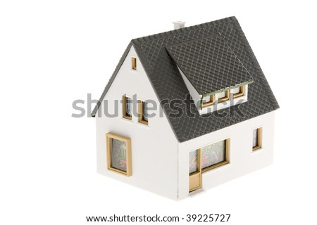Close-up of toy house model on white background