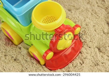 Close-up Of Toy Truck On the Kinetic Sand Heap Summer Beach Game Concept.