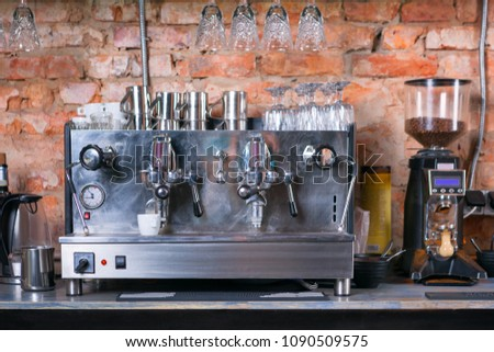Close up of traditional Espresso Coffee Machine and coffee grinder.