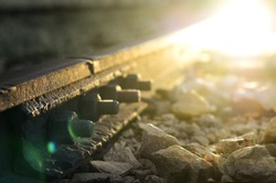 Close up of train railway steel track with head light of coming train