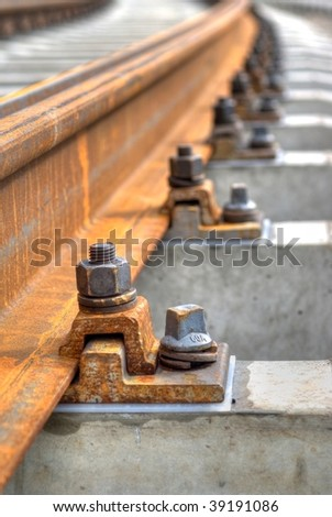 close up of trolley tracks. Focus on first bolt.  Shallow depth of field
