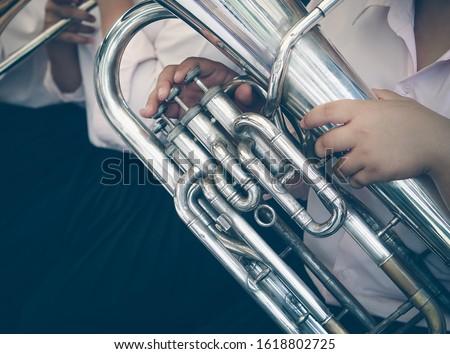 Close up of tuba musician, Presentation of the brass band. The instrument of the brass band tuba. Сток-фото ©