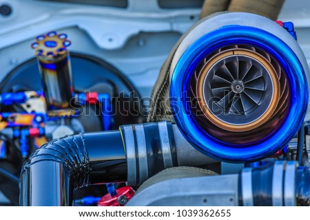Photo of  Close up of Turbo charger installed on car engine for power booster torque drive, Turbo car engine showing inner parts and turbine Compressed air in car.