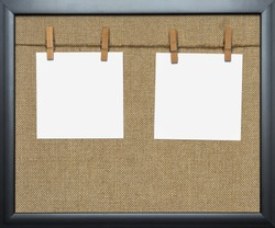 Close-up of two blank notes hanged by pegs on a washing line against natural jute background. Portfolio photo frame. Noticeboard for School or Business use