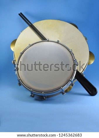Close-up of two Brazilian musical percussion instruments: pandeiro (tambourine) and tamborim with drumstick. They are widely used to accompany samba, the most popular Brazilian rhythm.
