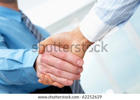 Close-up of two businessmen hands shaking