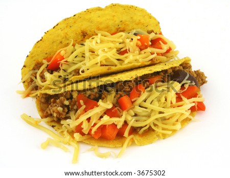 close-up of two delicious Mexican Tacos against white background