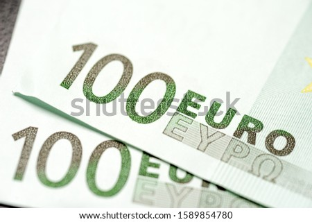 Close-up of two hundred euro bills lies in each other. Concept banknotes currency of the European Union. Concept stable currencies crises and exchange rates