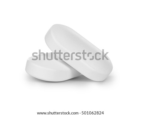 close-up of two pills isolated on white background