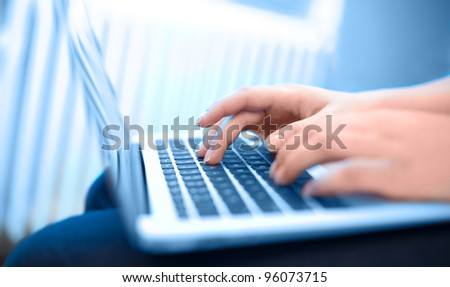 Close-up of typing female hands