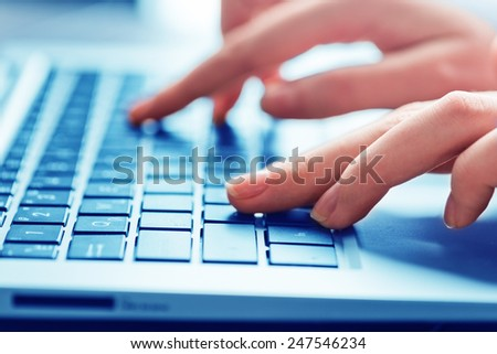 Close-up of typing female hands on keyboard #247546234