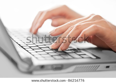 Close-up of typing female hands, selective focus