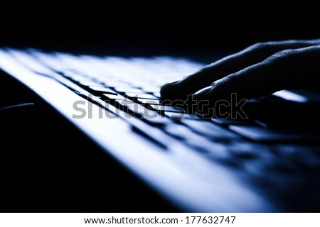 Close-up of typing male hands on keyboard - stock photo