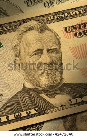 Close-up of Ulysses S. Grant on the $50 bill, dramatically lit.