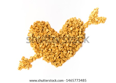 Close up of uncooked rolled oats (oat flakes) shape form heart isolated on white background. Concept :Love healthy food ,Vegan food ,Raw food ,Valentine 's day.