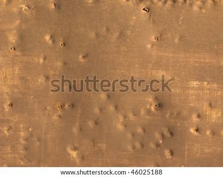 Close up of uneven brown colored metal background - stock photo