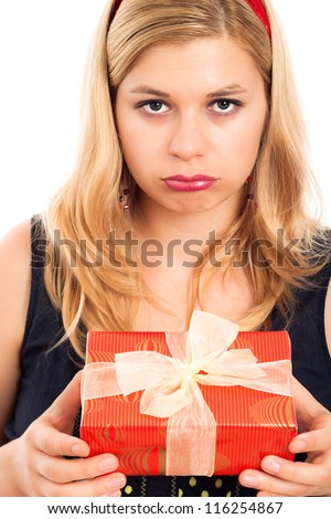 Close up of unhappy disappointed woman holding small gift box.
