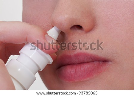 Close-up of unrecognizable woman who about to use nasal spray