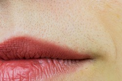 Close up of unwanted hair in upper lip area of a woman