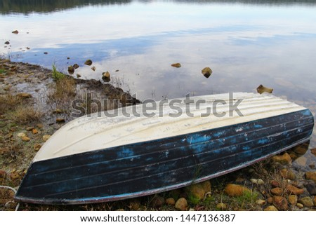 Close -up of Upturned Dinghy on a Lake Shore