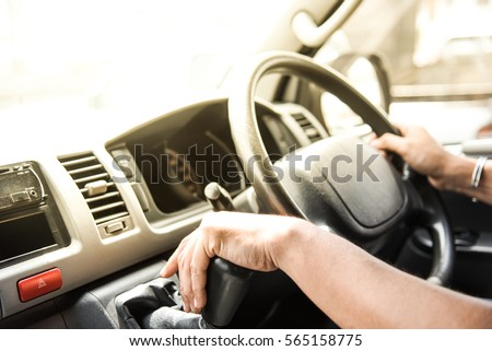 Close up of van driver driving passenger bus #565158775