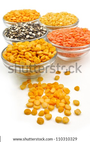 close up of variety of split husked pulses kept in glass pot