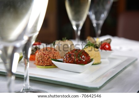 Close up of various appetizer between glasses