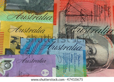 "Close up of various Australian dollar notes. Focus on ""Australia"" on blue $10 note"