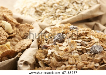 Close-up of various breakfast cereals in paper bags.