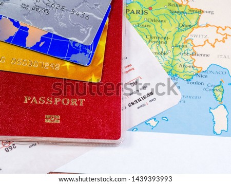 Close-up of various passport, credit cards on a map #1439393993
