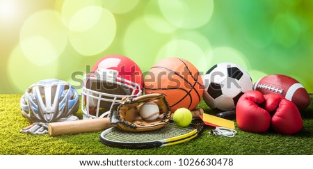 Close-up Of Various Sport Equipments On Pitch Against Bokeh Background #1026630478