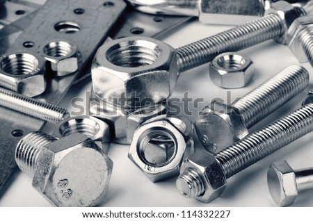 Close-up of various steel nuts and bolts #114332227