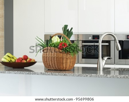 Close -up of vegetables and fruits in a modern kitchen interior