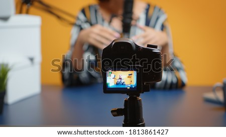 Photo of  Close up of video blogger recording subscribers present giveaway. Creative content creator social media star influencer expert vlogger recording online internet web podcast gift for audience