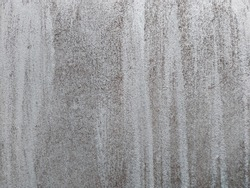 Close-up of vintage background with black brushstrokes on gray wall. Hand drawn subtle grunge texture.