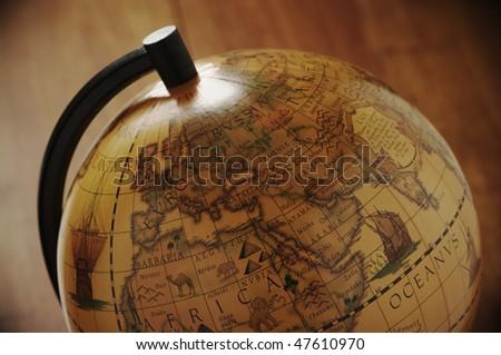 Close-up of vintage globe in back light.