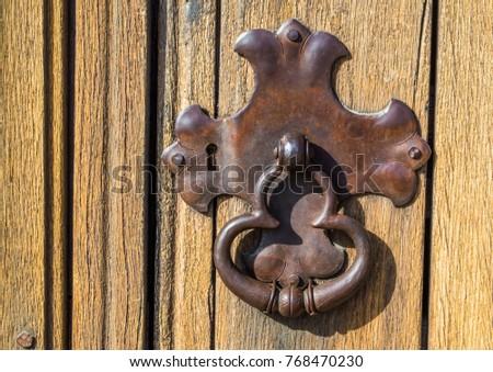 close up of vintage metal lock...